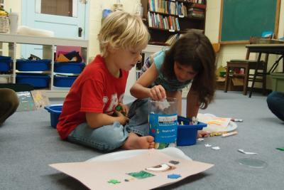 Two children choose cutout figures